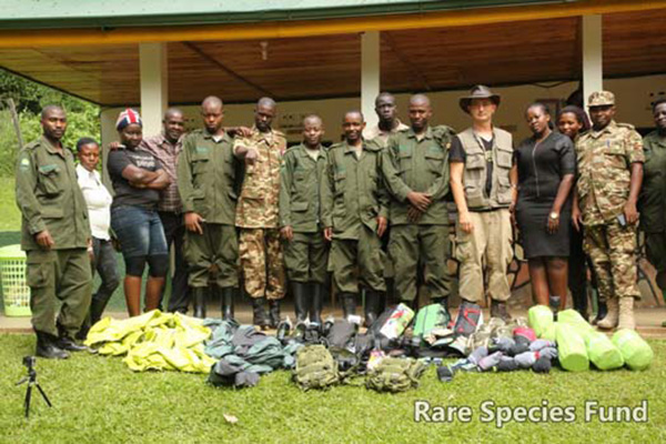 UWA officials and rangers pose with RSF staff in front Kibale National Park Hdqtrs. with equipment supplied and delivered by the Rare Species Fund.